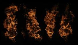 Una selezione di quattro fiamme del fuoco Fotografie Stock Libere da Diritti