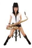 Una sentada del saxofonista. Fotografía de archivo