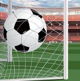 Una sfera di calcio nel cancello fotografie stock libere da diritti