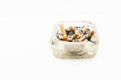 Una sigaretta con i resti di conclusione della cenere Fotografie Stock Libere da Diritti