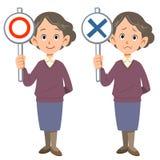 Una signora anziana mostra le risposte, l'APPROVAZIONE e la NG illustrazione di stock