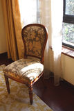 Una silla en dormitorio Fotos de archivo libres de regalías