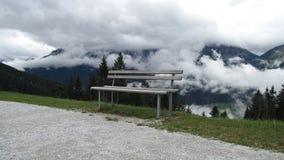 Una silla sobre las nubes Imágenes de archivo libres de regalías
