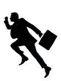 Una silueta corriente de salto del hombre de negocios foto de archivo