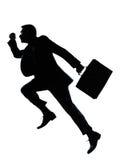 Una silueta corriente de salto del hombre de negocios Fotografía de archivo