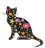 Una silueta de un gato con las flores Imagen de archivo libre de regalías