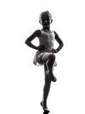 Una silueta del baile del bailarín de ballet de la bailarina de la niña Fotos de archivo