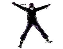 Una silueta del esquí del esquiador de la mujer Imagenes de archivo