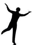 Una siluetta di diffusione felice delle braccia dell'uomo di affari Immagini Stock Libere da Diritti