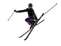 Una siluetta di salto di corsa con gli sci dello sciatore della donna Immagini Stock