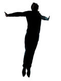 Una siluetta di salto di volo dell'uomo di affari Immagini Stock