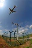 Una siluetta di un aeroplano Immagine Stock
