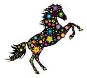 Una siluetta di un cavallo con i fiori Fotografie Stock Libere da Diritti