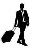 Una siluetta di un viaggiatore di affari Fotografia Stock Libera da Diritti
