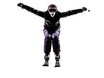 Una siluetta gridante di salto di corsa con gli sci dello sciatore della donna Fotografie Stock Libere da Diritti