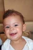 Una sonrisa adorable del bebé Fotos de archivo libres de regalías