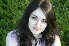 Una sonrisa de la muchacha Imágenes de archivo libres de regalías