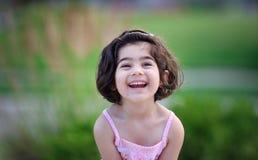 Una sonrisa de la niña Foto de archivo