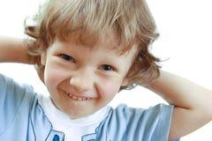 Una sonrisa del muchacho Imagenes de archivo