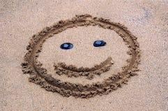 Una sonrisa en la arena Imagenes de archivo