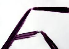 Una spazzola disegna le linee rette agli angoli differenti fotografia stock
