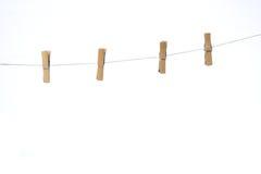 Una spina di quattro vestiti Fotografia Stock