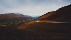Una strada attraverso una valle Fotografia Stock Libera da Diritti