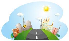 Una strada che va alla città con le fabbriche Fotografia Stock Libera da Diritti