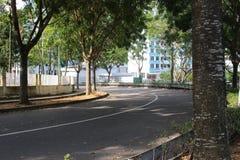 Una strada vuota a metà a Singapore Fotografia Stock Libera da Diritti