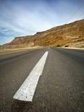 Strada asfaltata del deserto Fotografia Stock