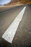 Strada asfaltata del deserto Fotografie Stock Libere da Diritti