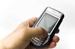 Una stretta della mano un microtelefono immagine stock