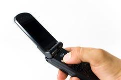 Una stretta della mano un microtelefono immagine stock libera da diritti