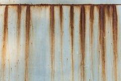 Una struttura arrugginita del metallo del ferro ondulato Fotografie Stock Libere da Diritti