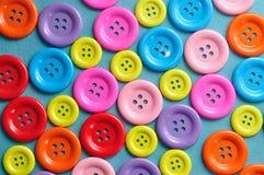 Una struttura completa dei bottoni variopinti per cucire Fotografia Stock Libera da Diritti
