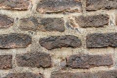Una struttura scura del fondo del muro di mattoni Immagine Stock