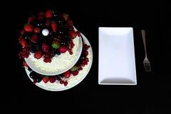 Una tabla de la torta de la fruta Imagen de archivo libre de regalías