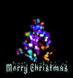 Una tarjeta de la Feliz Navidad con el árbol y las luces LED de abeto Fotos de archivo