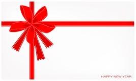 Una tarjeta del Año Nuevo con la cinta roja Fotos de archivo libres de regalías