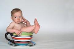 Una taza de bebé Foto de archivo libre de regalías