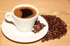 Una taza de noche del café Imagen de archivo libre de regalías