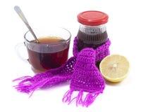 Una taza de té con el atasco y el limón Foto de archivo libre de regalías