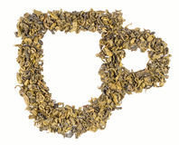 Una taza de té hecha de hojas de té Foto de archivo