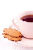 Una taza de té y de galleta Imagen de archivo