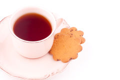 Una taza de té y de galleta Fotografía de archivo libre de regalías