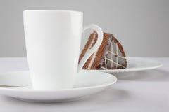 Una taza de té y de torta Fotos de archivo libres de regalías
