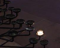 Una taza de vela en el soporte de la vela Fotografía de archivo libre de regalías