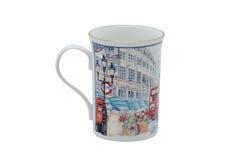 Una taza hermosa hecha de la porcelana de la calidad de los colectores y adornada con los estampados de flores y el ejemplo Foto de archivo