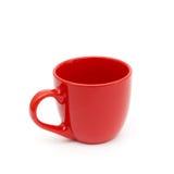 Una taza roja vacía Imagenes de archivo