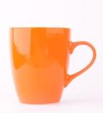 Una tazza arancio Fotografia Stock